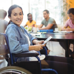 Girl in wheelchair holding a tablet
