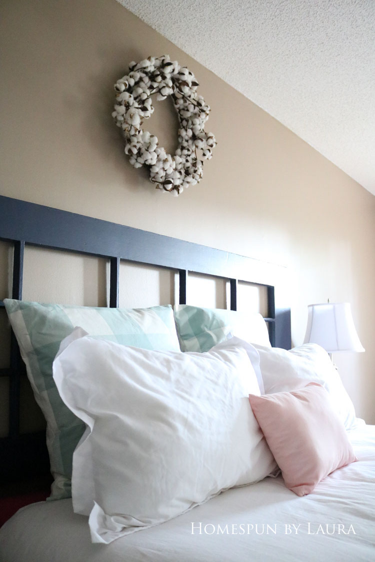 Master bedroom refresh | Homespun by Laura | Budget master bedroom farmhouse style redecoration with cotton wreath over bed