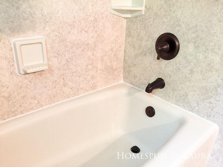 Replacing old caulk makes a dramatic impact in a bathroom. | Homespun by Laura