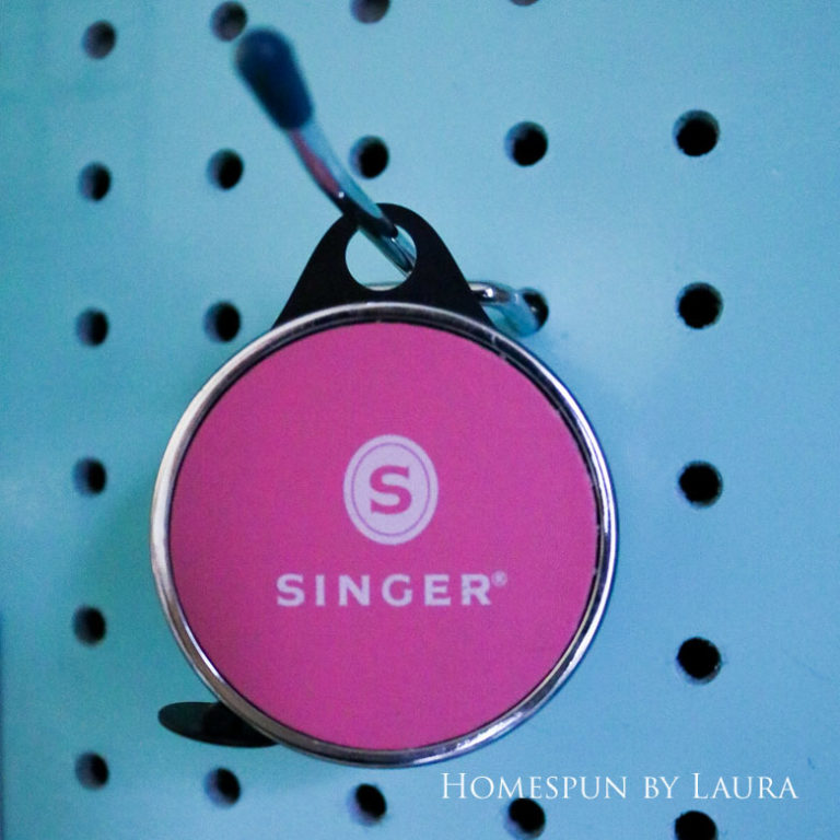 High quality retractable tape measure by Singer - and it's pink!   Homespun by Laura