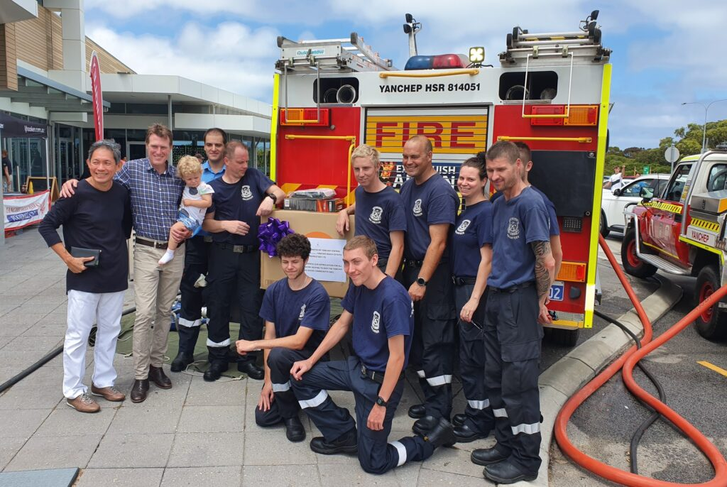 Yanchep Volunteer Fire and Rescue members with YBJV chief executive Gin Wah Ang and Pearce MHR Christian Porter and his daughter Florence.