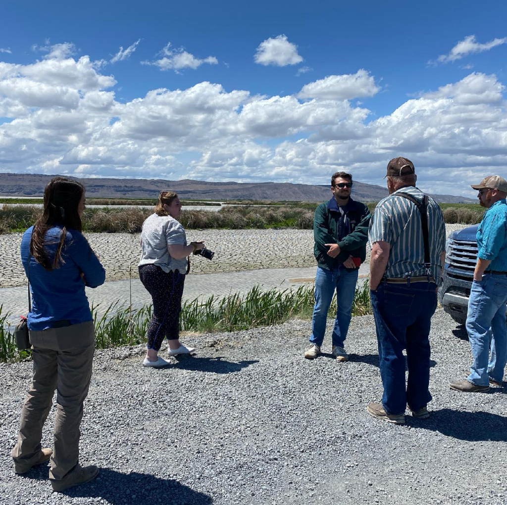 John Crawford and TID manager Brad Kirby talking to reporters at a drained Sump 1A on the Tulelake Wildlife Refuge