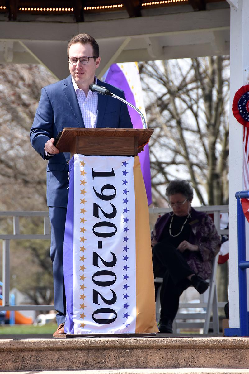 Steve Bodnar, at podium, banner says 1920- 2020