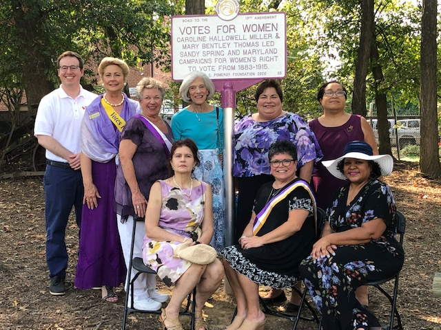 MWHC Board members and volunteers, with Steve Bodnar, William G. Pomeroy Foundation. Front: Christine Valeriann, Amy Rosenkrans, Kalin Thomas. Back: Steve Bodnar, Kate Campbell Stvenson, Diana Bailey, Pam Young, Maria Darby, Jean Thompson standing with the historical marker