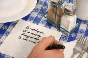 Apologies written on a napkin