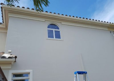 Professional painting beautifies and protects smooth stucco finish