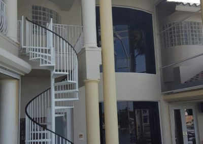 In the process of painting two story circular staircase at Marco Island home