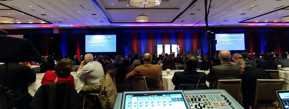 View from behind the AV tech table at a conference