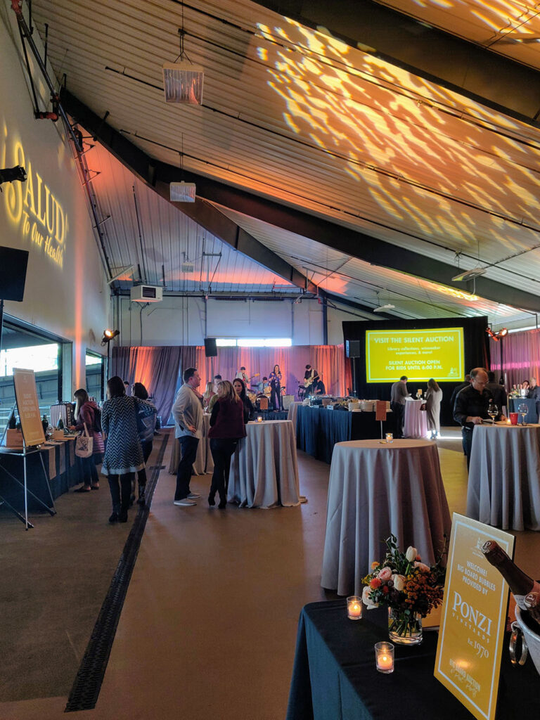 Oregon winery set for special event. Salud logo is projected on the wall