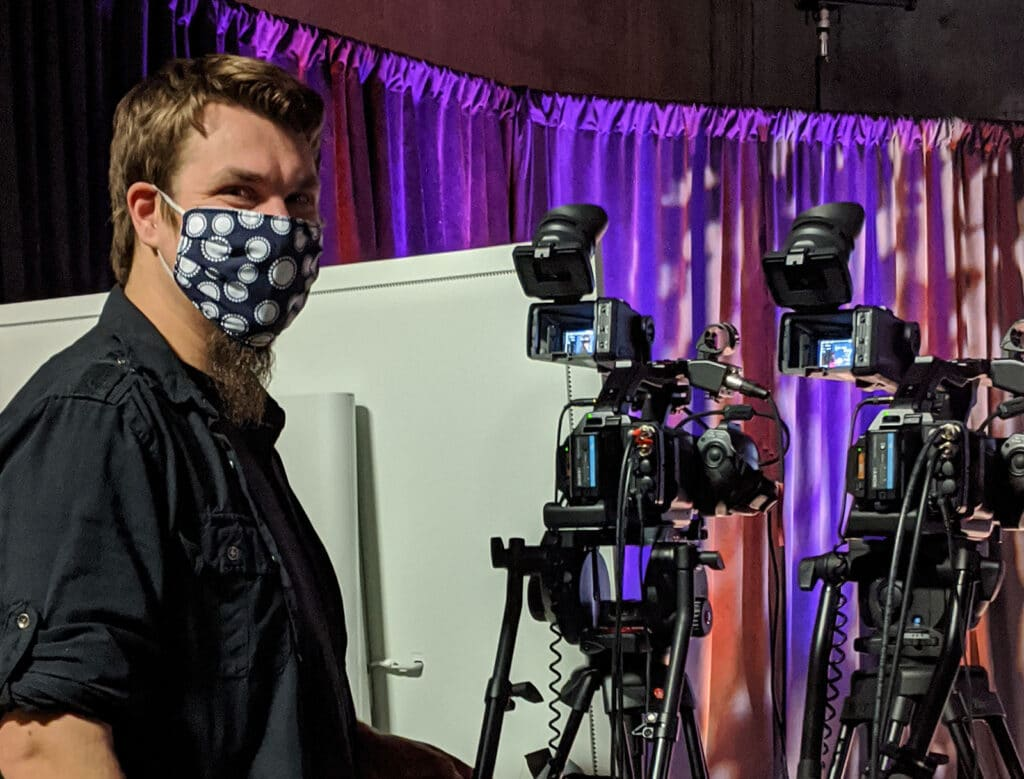 videographer wears a mask while working
