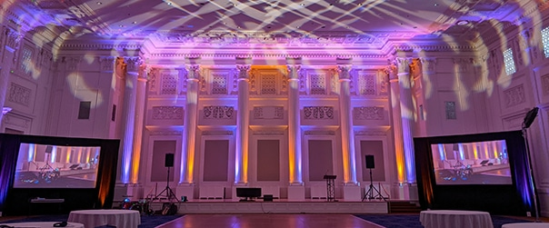 The Governor Ballroom in the Sentinel Hotel in Portland Oregon is set for an event with uplighting, large screens, projection