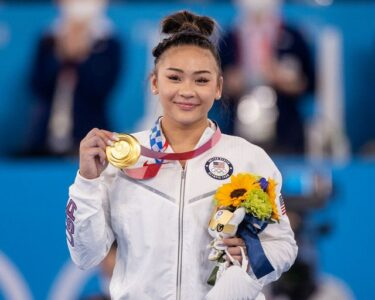 sunisa-lee-of-the-united-states-on-the-podium-with-her-gold-news-photo-1627568866