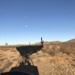 Hot Air Balloon Shadow Over the Desert