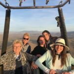 happy passengers in a hot air balloon - arizona