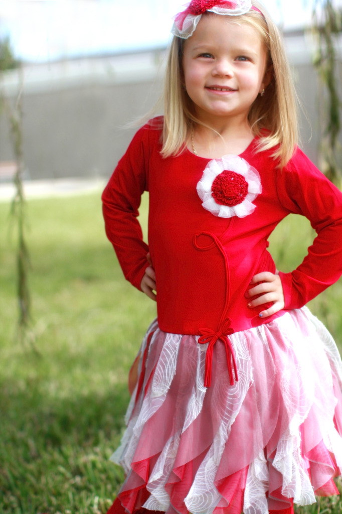 Valentina is wearing the Dallas Doll, style 8331RD, available in size 2T-14.