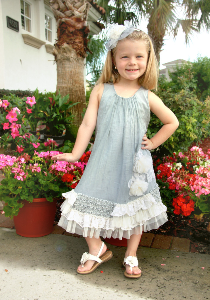 Valentina is wearing Vicki, which is available in sizes 12M-16.