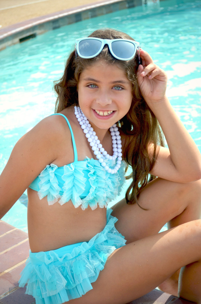Madison is wearing Makin' A Splash bikini, style 8684TY in size 2T-14, available in stores now.