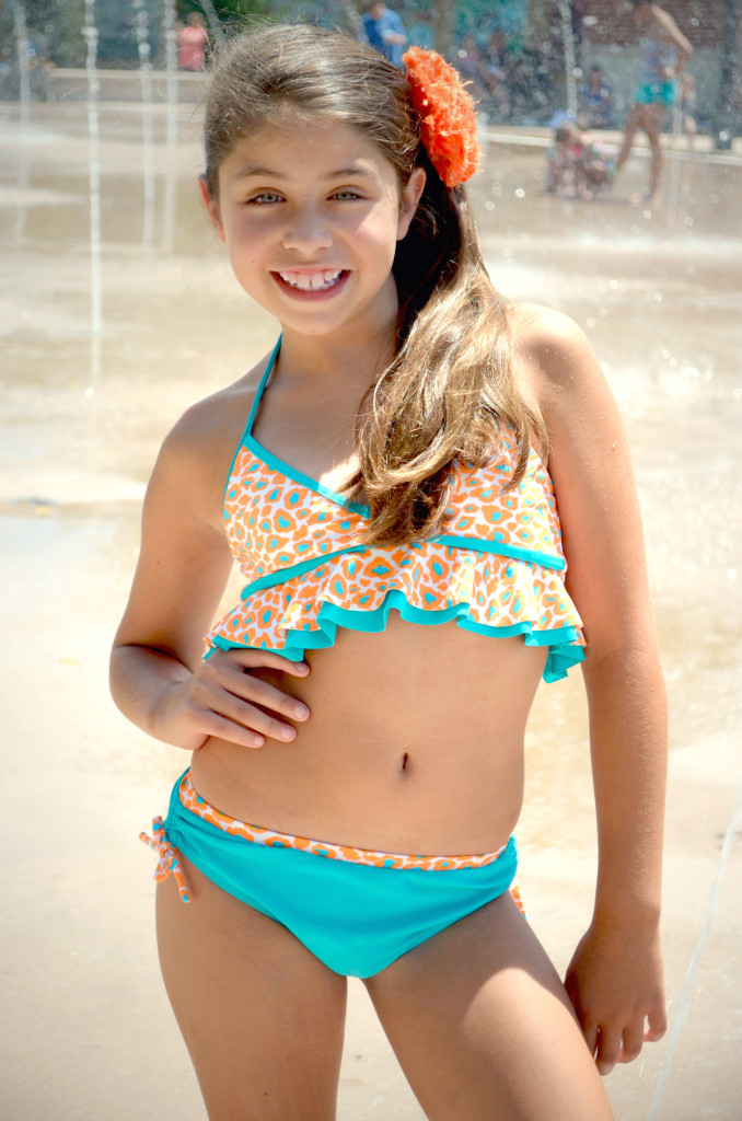 Madison is wearing style Sun, Sand, & Surf, style 8704TL, available in sizes 4-14.