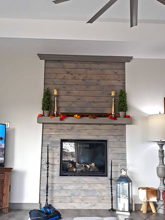 Fireplace with wood paneling
