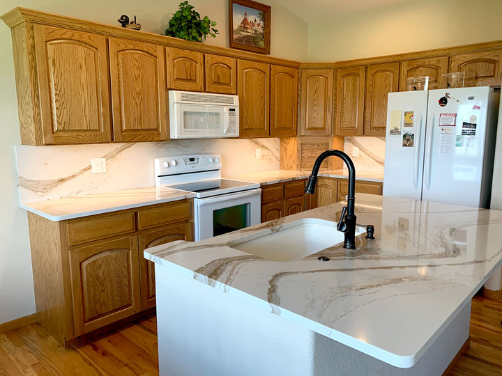 Refinished kitchen with marble & oak