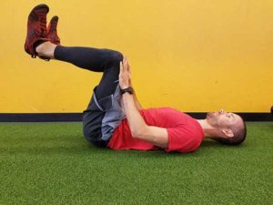 Personal trainer performing core pressure hold in Vancouver, WA