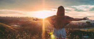 Girl watching sunrise