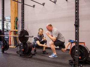 Personal Trainer Trevor working on lunges with client