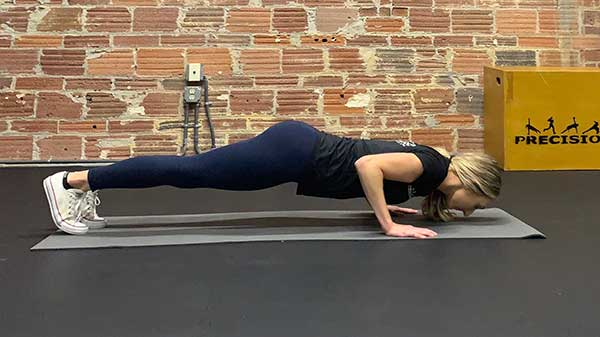 Standard push up with proper form in lower position