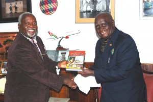 """President Kaunda receives a copy of the book: """"Satisfying Zambian Hunger fro Culture"""" from Professor Tembo in November 2012."""