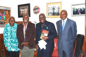 """After President Kaunda received the book: """"Satisfying Zambian Hunger for Culture"""". From right to left: The author's late Uncle Mr. J. J. Mayovu, President Kaunda, Professor Tembo, and Mr. Mfula."""