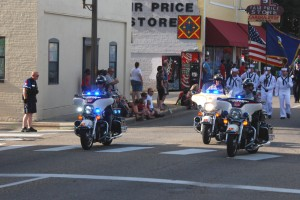 Police officers maintaining peace in a city 4th of July Independence Day parade.