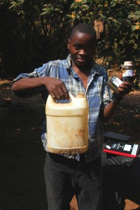 Abiudi Banda showing me a plastic container which can heat water by inserting electrodes in the container.