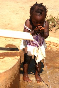 Kukaya is where children drink fresh clean water from a hand driven borehole pump.