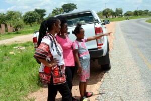 Temwani pointing to the beautiful valley. Marita Banda in the middle and Mulenga Kapwepwe.