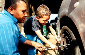 Fathers must spend time with their children teaching them how perform certain tasks such as how to change a flat tire.