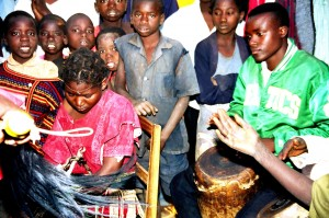 The young girl in the chair (left) is a patient performing the Vimbuza Dance to exorcise spirits that are believed to come from no where.