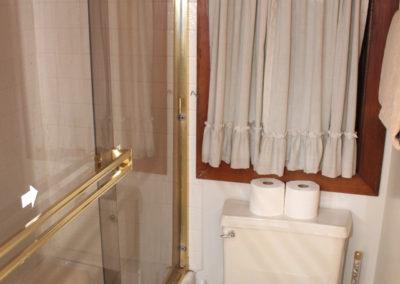 Bath #3: tub/shower, toilet, and sink.