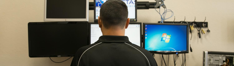 man at computer desk