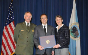Chris Baker receiving the Partners in Conservation Award on behalf of ACE from Secretary of Interior Sally Jewell and National Park Service Director Jonathan Jarvis.
