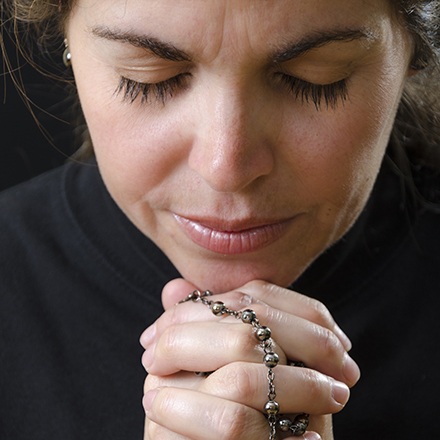 Woman with Rosary