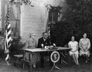 The signing of ESEA into law by LBJ, 1965
