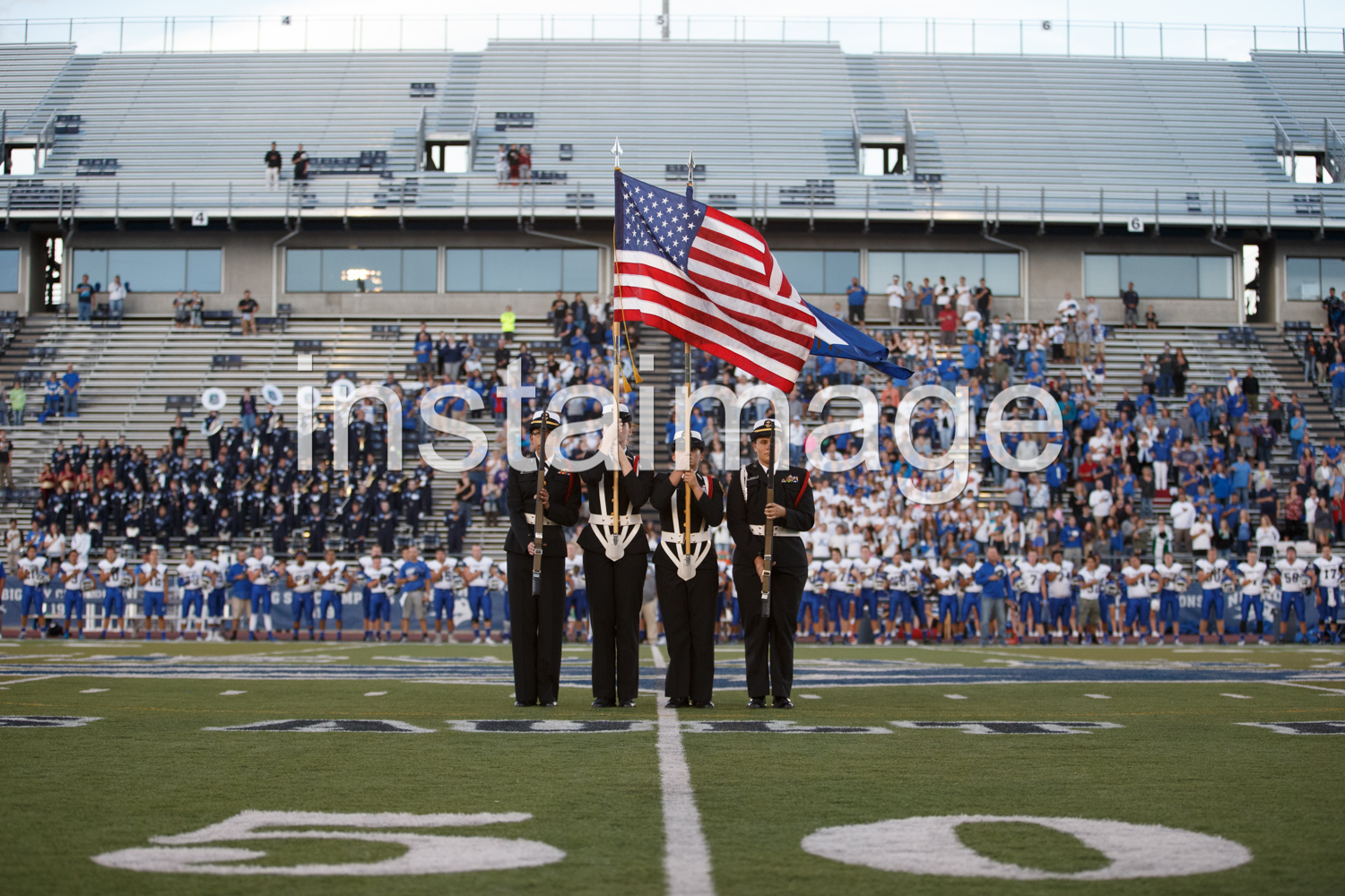 Carson High Navy Jr. ROTC members display the colors before the game.