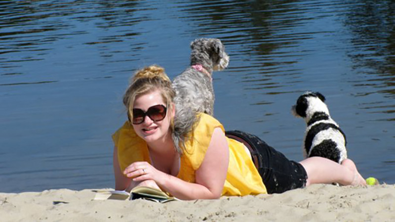Dog sitting on woman's shoulders