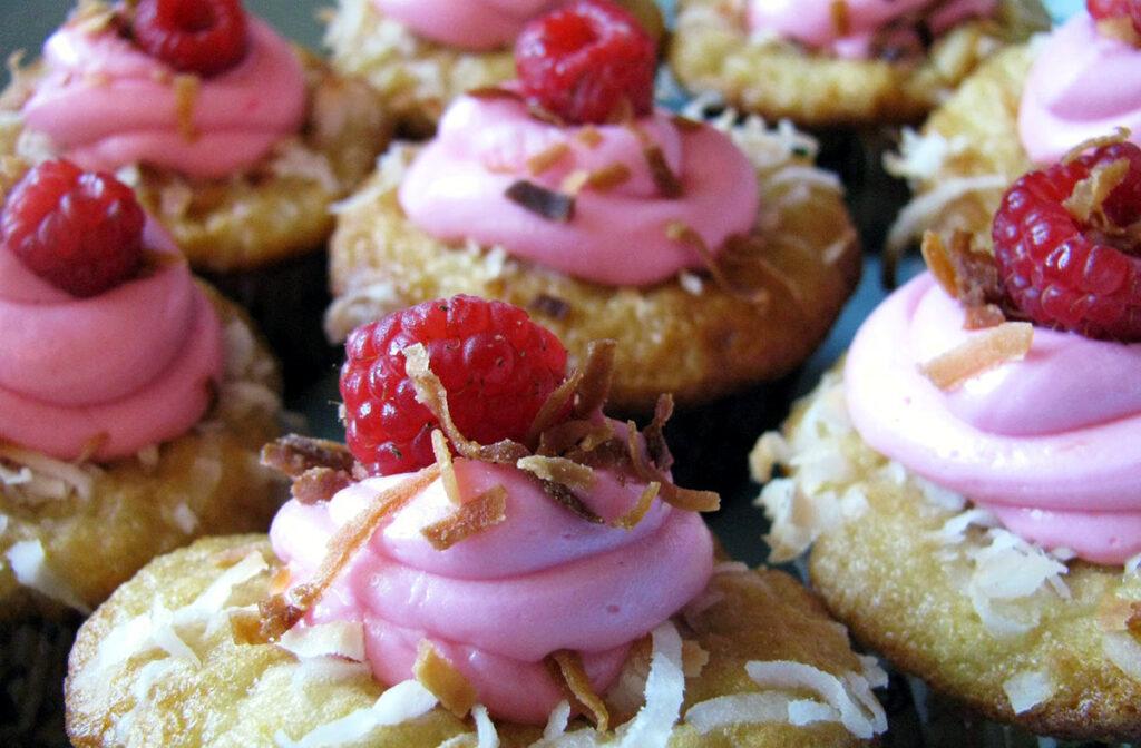 Raspberries on top of cupcakes