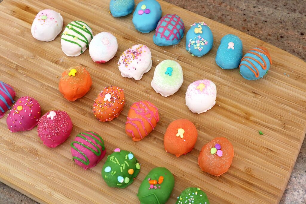 Colored Easter Egg Cake Bites in a Row on a Platter