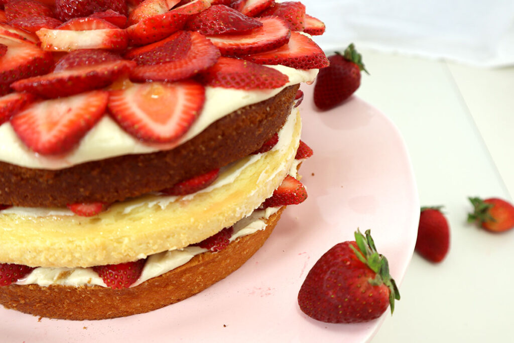 Side view of strawberries and cream cake
