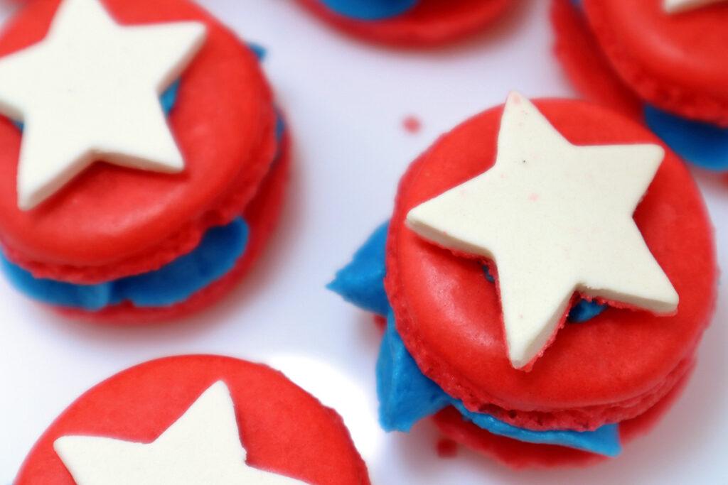 White Sugar Icing Stars on Red Macarons
