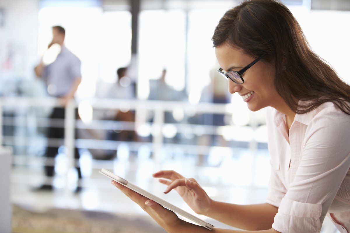 happy woman using easy work order's enterprise saas software to check on her portfolio