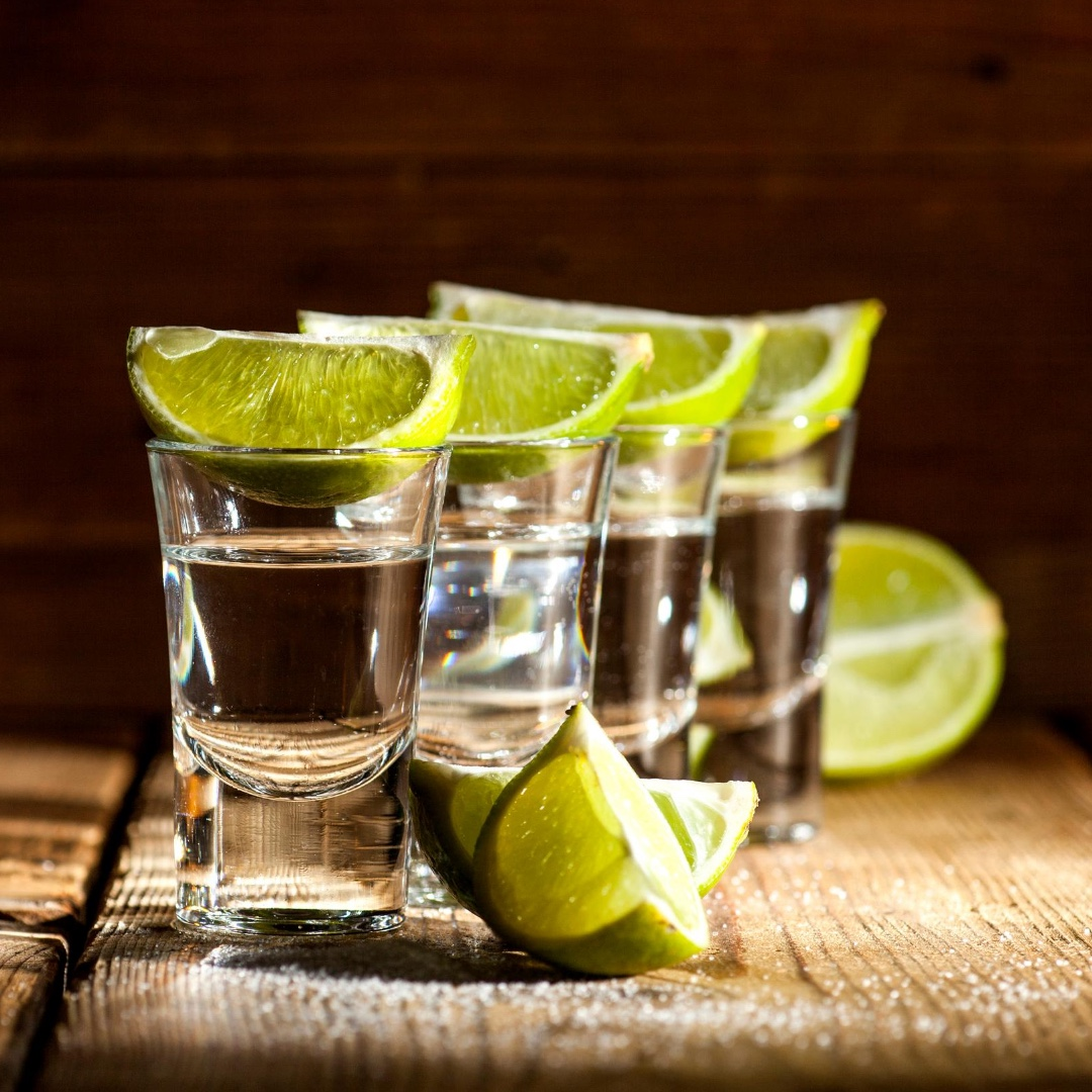 Tropical tequila shots with lime