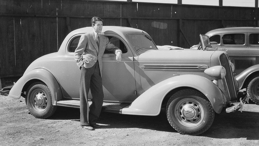 James Stewart American actor James Stewart (1908-1997) leaning against a 1936 Plymouth. April 1, 1936
